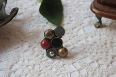 Repurposed button ring in gold, silver, red and black by RaznoRaznoShop on Etsy