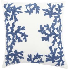 Add a touch of coastal charm to your favorite arm chair or reading nook with this delightful pillow, showcasing a coral design in blue.
