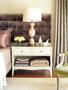 I like a good large bedside table to display favorite items and keep books and blankets nearby!  I also love this extended headboard.