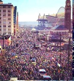 View from just north of Century Link stadium on February 5 2014 Seattle Celebrate SuperBowl XLVIII Champion Seahawks with 700,000+ storming the city from all over the region. Mariner's SafeCo field just behind CLink. #GoHawks