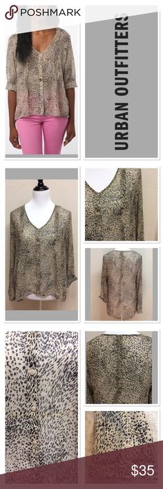 "M URBAN OUTFITTERS pins and needles animal print Brand: pins and needles for urban outfitters  Style: hi lo button up sheer blouse Size: m Measurements: pit to pit 19.5"" shoulder to hem 23.5""-27"" Material: 100% polyester Features: animal print, pin tucked pleats, roll up sleeves Condition: EUC Urban Outfitters Tops"
