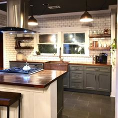 """Galley kitchen with bar island containing stove and vent hood - Sinkology (@sinkology) on Instagram: """"So much to ❤️ in this kitchen from @theoroots_! ✨What's your favorite part?✨"""""""