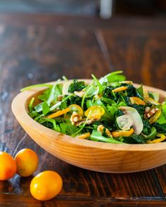Kale Kumquat Salad - http://www.steamykitchen.com/30289-kale-kumquat-salad-recipe-video.html