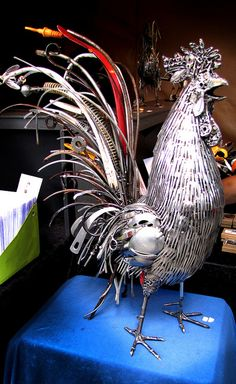 Upcycled kitchen utensil rooster metal sculpture by Brian Mock at the Saturday Market in Portland, Oregon