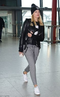 Laid back: Margot Robbie cut a casual figure on Monday when she was spotted at London's Heathrow Airport