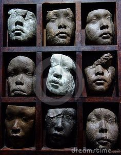 Face sculpture by Zheng Dong, via Dreamstime
