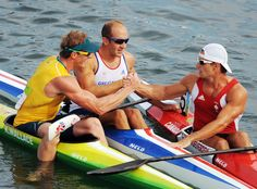 Adam Van Koeverden (L to R) Ken Wallace of Australia celebrates with bronze medalist Tim Brabants of Great Britain and silver medalist Adam van Koeverden of Canada after winning the Mens Kayak Single K1 Flatwater Final on Day 15 of the Beijing 2008 Olympic Games at the Shunyi Rowing and Canoeing Park on August 22, 2008 in Beijing, China.