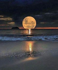 The moon rising over the ocean
