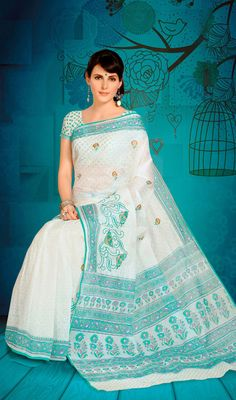 Traditional Embroidered Cotton Printed Sari Amaze the crowd draped in this traditional off white shade cotton sari. Saree is beautifully accentuated with printed decorative and embroidered floral patterns. Contrast fancy border adds to the look. Comes with a matching stitched round neck blouse with 6 inches sleeves. #CottonPrintedSari #SilkCottonSareeOnlineIndia