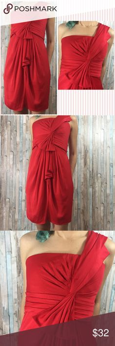 """BCBGMaxazria one shoulder Red Cocktail Dress Hello BCBGMaxazria Dress, how are you so made so beautifully?? 😍 Vidid red, showstopper, features an intricate but elegant shoulder design, in great condition, still has a dry cleaner tag on it, its a statement piece, evening/party dress. 100% Polyester 26"""" waist 32"""" from shoulder. Gorgeous all over!  I appreciate you checking it out, please see the rest of my closet 7% off on all bundles 🙏❤️ BCBGMaxAzria Dresses Midi"""