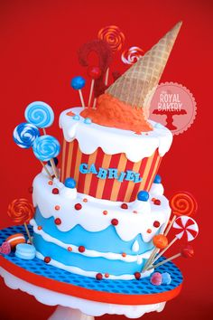 Candy and Ice Cream Cake ❤❤ - All candy and lollipops are fondant, ice cream is RKT dipped in candy melts.    The lollipops are dipped in a 50/50 mixture of corn syrup and vodka which dries to a dry shiny finish overnight.