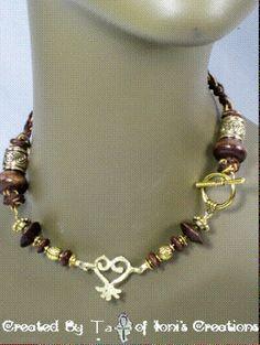 https://www.etsy.com/listing/123393895/sankofa-adinkra-beaded-crochet-necklace