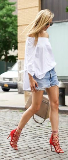 As simple as it gets. White off the shoulder top with a pair of denim cut-offs and red sandals. Via Lisa D Cahue  Top: Tibi, Shorts: Levi's, Shoes: Schutz, Bag: Celine. Off the shoulder outfits