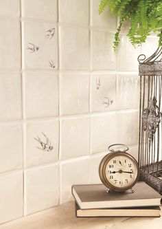 Fine illustrations depict swooping swallows. Handmade ceramic tiles, made in the UK. winchestertiles.com