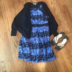 """Beautiful ELLE dress Blue and black floral pattern. NEVER WORN!!  Only the dress is for sale ( not the cardigan or shoes ). Zips on the side.  Has pleats from waist  down.  Shoulder to hem is approximately 36"""" Elle Dresses"""