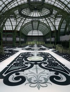 sometimes-now:  French garden under the glass ceiling of the Grand Palais - Chanel fashion show set S/S RTW 2011
