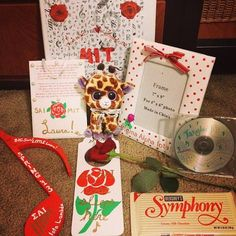 "First of all, a binder  A door hanger with a rose that read ""Shhh…an SAI rose sleeps here!""  A polka dot picture frame with a bow (for holding our first pic as a family)  A music note with our names, the semester, our letters and our Pan Pipes!  A symphony chocolate bar and rose  copy of Tangled soundtrack  stuffed ""Lucky giraffe"""