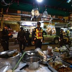 Police inspect a near-empty parking where the popular and busy night market should have been held in the upscale resort town of Hua Hin on August 12, 2016. A string of bomb attacks targeting Thailand's crucial tourism industry have killed four people, officials said on August 12, sending authorities scrambling to identify a motive and find the perpetrators. / AFP PHOTO / LILLIAN SUWANRUMPHALILLIAN SUWANRUMPHA/AFP/Getty Images