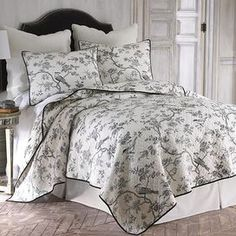 """Add a charming touch to your master suite or guest room with this lovely cotton quilt set, showcasing a toile motif for eye-catching appeal.     Product: Twin: 1 Quilt and 1 standard shamFull/Queen: 1 Quilt and 2 standard shamsKing: 1 Quilt and 2 king shams Construction Material: CottonColor: Ivory and blackFeatures: Pre-washed  Dimensions:    Twin Quilt: 68"""" x 86"""" Full/Queen Quilt: 88"""" x 92""""  King Quilt: 106"""" x 92""""    Note: Shams do not include ..."""