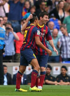 Alexis Sanchez of FC Barcelona celebrates with Lionel Messi after scoring the opening goal during the La Liga match between FC Barcelona and Club Atletico de Madrid at Camp Nou on May 17, 2014 in Barcelona, Catalonia.