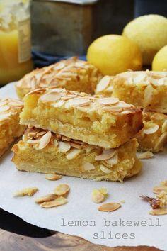 Lemon Bakewell slices by Scrummy Lane - such an easy 'impressive' dessert! Lemon Desserts, Just Desserts, Delicious Desserts, Yummy Food, Baking Recipes, Cookie Recipes, Dessert Recipes, Cupcakes, British Baking