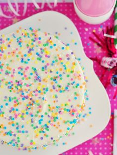 funfetti layer cake with whipped vanilla frosting - rainbow sprinkles in the batter AND on the frosting. mmm.