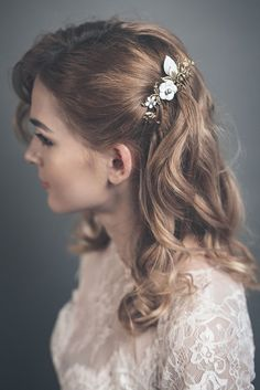 This feminine wedding hair comb is the perfect little something to add to a bridal up-do.It has a gold brass leaves with flowers and berries, white enameled flo