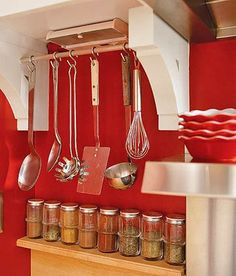 install two end wooden brackets under a narrow kitchen cabinet, install a short curtain rod or other decorative bar, and hang kitchen utensils that don't fit in drawers. I would like a series of these, under all kitchen shelves. Kitchen Utensil Storage, Cutlery Storage, Pan Storage, Kitchen Utensils, Kitchen Organization, Storage Ideas, Storage Solutions, Organization Ideas, Kitchen Tools