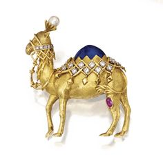 18 KARAT GOLD, LAPIS LAZULI, DIAMOND, RUBY AND CULTURED PEARL CAMEL BROOCH, SCHLUMBERGER FOR TIFFANY & CO. The camel set with a cabochon lapis lazuli segment, a cultured pearl, an oval ruby, and round diamonds weighing approximately 1.00 carat, signed Tiffany, Schlumberger.