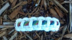 White Paracord Bracelet with Dark Rainbow Stripe Purple Camo, White Camo, Paracord Ideas, 550 Paracord, Survival Bracelets, Paracord Bracelets, Cobra Weave, Thing 1, Light Turquoise