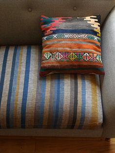 nice-> love the idea of covering just the cushions in another fabric - both to protect and to shake things up.