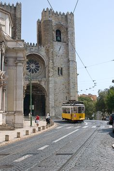 """Alfama District - #Lisbon Cathedral and the mythical """"electrico 28""""."""