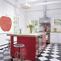 "SJP House in Hamptons - He created a clean, crisp backdrop by painting all the rooms with Benjamin Moore Super White. ""I wanted to let the architecture speak for itself,"" he explains, ""and then fill the rooms with punches of color and simple pieces with lots of character."" At Parker's request, the kitchen cabinetry is a glossy tulip red."