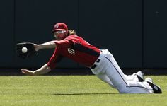 Washington Nationals outfielder Jayson Werth dives to catch a fly ball against the Detroit Tigers.