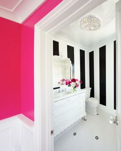 bathrooms - hot pink walls penny tiles floor white black vertical striped walls white vintage bathroom vanity marble countertop white mirror