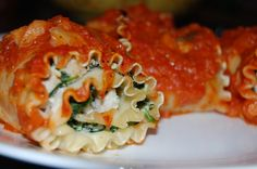 Giada s Lasagna Rolls from Food.com: Giada is a genius. I have actually made these ahead of time - just place them on a baking sheet in the freezer, and then transfer to a freezer bag when they're hard. When ready to eat: Pour some sauce on top and bake at 325°F for 30-40 minutes (I went low and slow from freezer to table). Super easy meal for entertaining or fast weekday dinner!