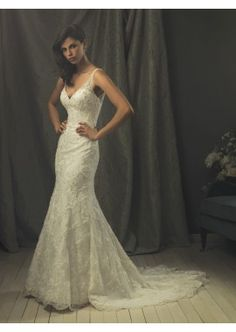 This vintage gown is in sheath silhouette, fully wrapped by glamorous semi-transparent lace overlay, which spreads to the sweetheart bust, and makes the straps. Sexy and stunning bridal dress for dream wedding! Wedding dress!