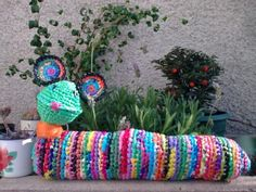 Crocheted plastic bag inch worm for your patio garden