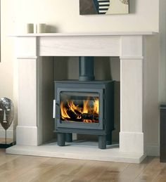 The Nordpeis Bergen has modern styling yet retains all the character of a wood-burning stove. Incorporating a clean and contemporary design, the Nordpeis Bergen is at home in many installations. Bergen, White Fireplace, Stove Fireplace, Interior Design Living Room, Living Room Designs, Best Wood Burning Stove, Contemporary Wood Burning Stoves, White Wood Floors, Marble Fireplaces