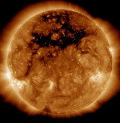 The sun has sprung a leak: A hole in the topmost layer of the sun and its magnetic field, the size of 50 Earths, is letting loose an ultrafast solar wind that has kicked off several nights of auroras down on Earth. A new image, from NASA's orbiting Solar Dynamics Observatory, reveals the enormous hole as it was Oct. 10, taken at an ultraviolet wavelength unseen by the human eye. To an ordinary observer, the gaping hole would be invisible, though you should NEVER stare at the sun because…