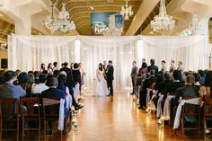 Romantic wedding ceremony held within Henry Ford Museum