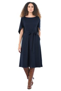 Stunning asymmetrical cocoon sleeves bring structured flounce to our wear-anywhere dress of soft cotton knit.