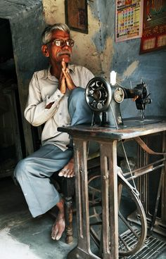 A tailor with his manual sewing machine Jodhpur, India