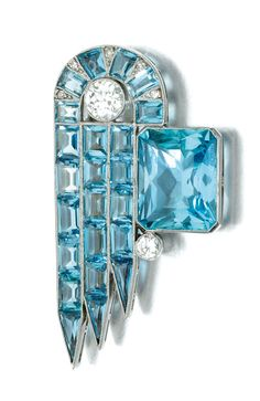 AQUAMARINE AND DIAMOND BROOCH, CIRCA 1925 Of geometric design, millegrain-set with step- and calibré-cut aquamarines, highlighted with circular- and single-cut diamonds.