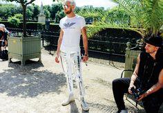 Matthew Foley in an Emporio Armani top, Moncler Gamme Bleu pants, and Converse shoes