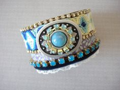 Bohemian hippie bracelet with a turquoise blue friendship bracelet and rhinestones on a leather cuff base...this is cool!