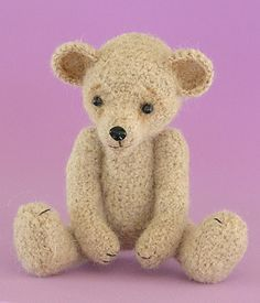 Little_brown_bear_sitting_front_small2