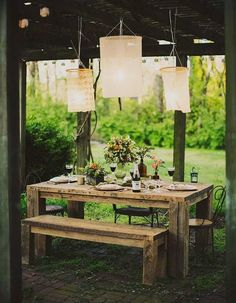 Gorgeous rustic tables with simple chandeliers turn any outdoor dining event into something picture worthy.