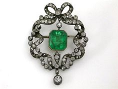 Antique Emerald Brooch 14 karat yellow gold with silver top edwardian bow brooch.