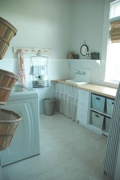 bathroom/laundry room ideas.  Love the sink and metal bins